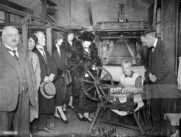 London England 7th April Mrs Stanley Baldwin wife of the former British prime Minister pictured admiring the work of Mrs Mary White at the Huguenot...