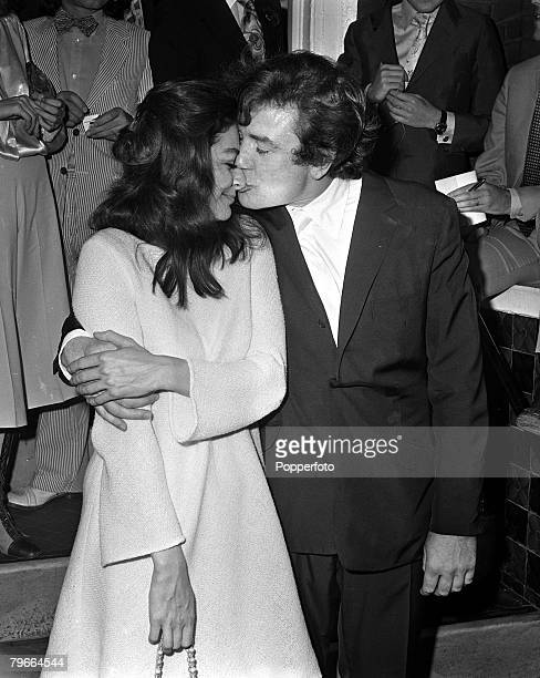 London England 7th August 1970 British actor Albert Finney kisses his French actress wife Anouk Aimee after their registry office wedding ceremony