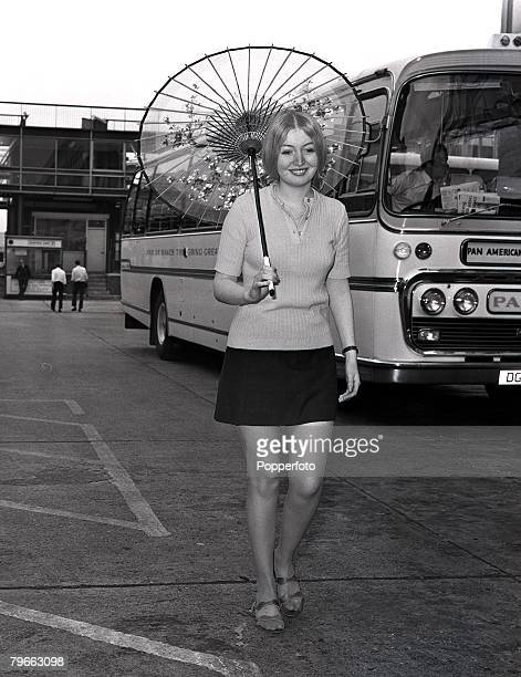 London England 8th July 1970 British singer Mary Hopkin holding an oriental parasol after arriving at Heathrow airport from Osaka Japan where she...
