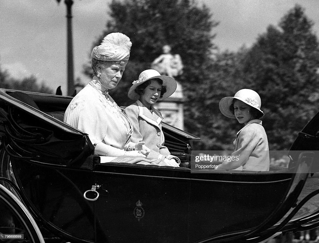 London, England, 9th June, 1938, Queen Mary with her granddaughters Princess Elizabeth (later Queen Elizabeth II) and Princess Margaret driving in horse drawn carriage to attend the Trooping of the Colour ceremony on Horse Guard's Parade : News Photo