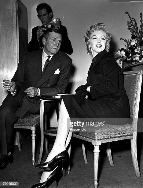 London, England, A picture of legendary British stage and screen actor Sir Laurence Olivier, with American actress Marilyn Monroe at a reception at...