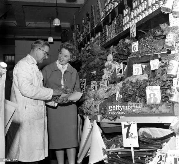 London England A stall holder and customer are pictured at a vegetable stand at the Covent Garden covered market