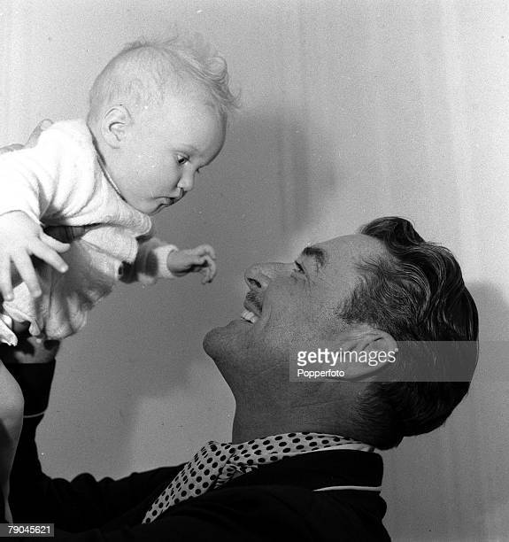 London England Actor Errol Flynn is pictured with his baby daughter Arnella Roura