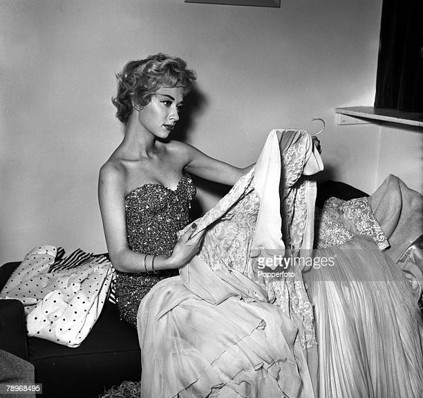 London, England Actress Carole Lesley is pictured with some of her clothes at home