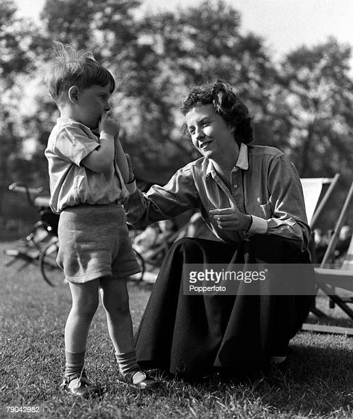 London England American actress Betsy Blair is pictured in a park with her son