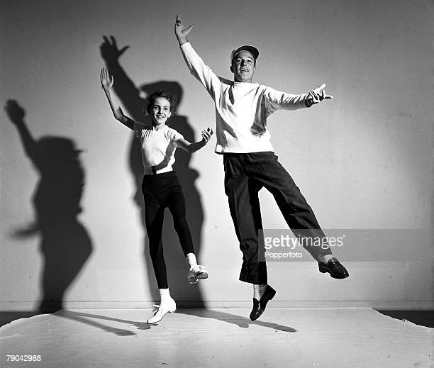 London England American dancer choreographer actor and director Gene Kelly is pictured dancing with 13 year old schoolgirl Julia Puccini