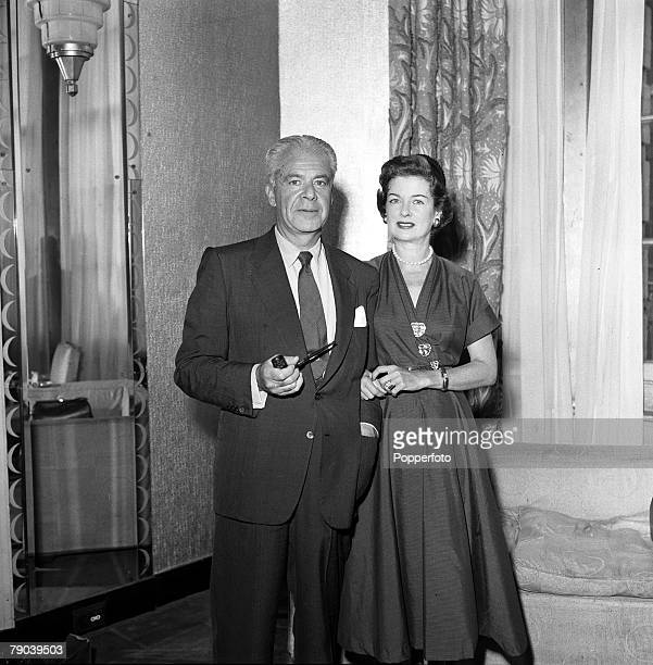 London England American film actress Joan Bennett is pictured with her husband Walter Wanger the US film producer at a press reception at Claridges