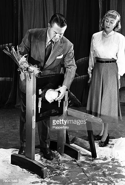 1948 London England American film star Chester Morris is pictured performing his Guillotine act at the Golders Green Hippodrome Chester's wife Lili...