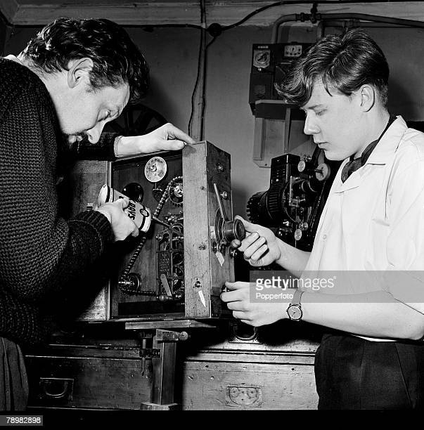 London England Animation and Film The office of a cartoon film unit Cartoonists Bob Godfrey and Keith Learner working on some equipment in their...