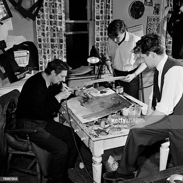 London England Animation and Film The office of a cartoon film unit Cartoonists Bob Godfrey Keith Learner Trevor Bond working their desk