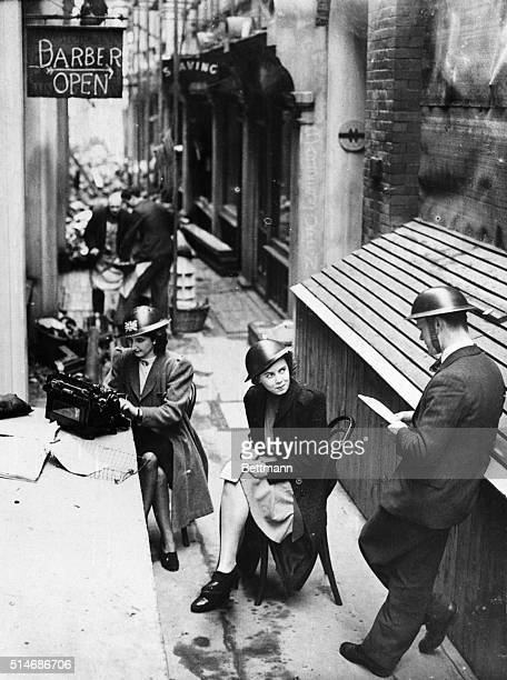 London, England: Bombed London office staff moves into street. Nazi bombing may have driven the members of this office staff into the street- but...