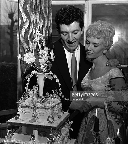 London England Boxer and actor Arthur Mason and his new wife actress Vera Day are pictured cutting the cake at their wedding reception