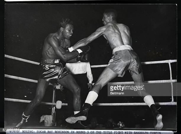 Boxing Sugar Ray Robinson in round 3 of the title fight with Randolpf Turpin British boxer at Earls Court