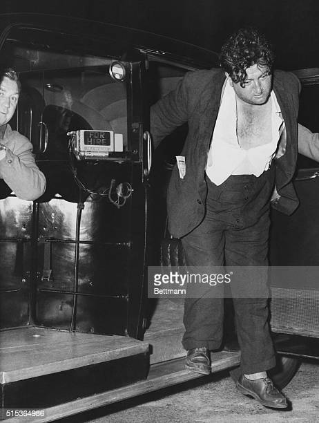 London, England: Brendan Behan, Irish playwright, stepping out of London taxi, dissipated.