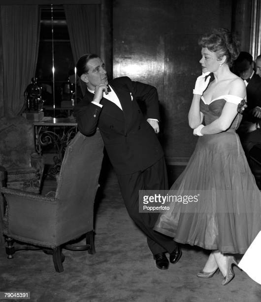 London England British actor and comedian Norman Wisdom is pictured with actress Glynis Johns at the British Film Academy Awards at the Odeon Cinema...