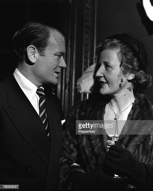 London England British Actor John Mills and Playwright wife Mary Haley Bell chat together at the 21st Birthday party of 'Spotlight' at The Ritz Hotel...