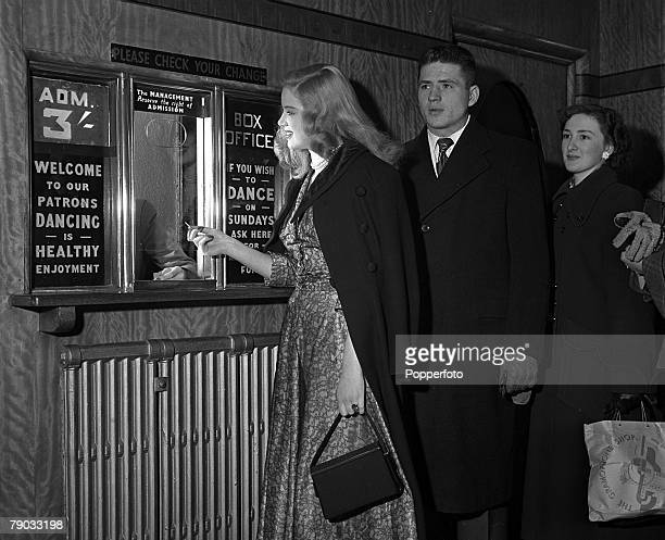 London England British actress Diana Dors is pictured paying at the box office of the Hammersmith Palais as she researches her role in the Ealing...