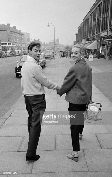 London England British film and movie actress Shirley Eaton walks hand in hand with her fiancee Colin LentonRowe down a street