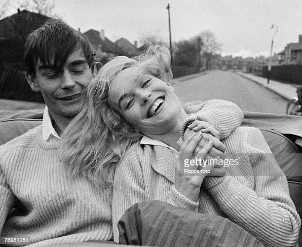 London England British film and movie actress Shirley Eaton with her fiancee Colin LentonRowe as they laugh in the back seat of a car