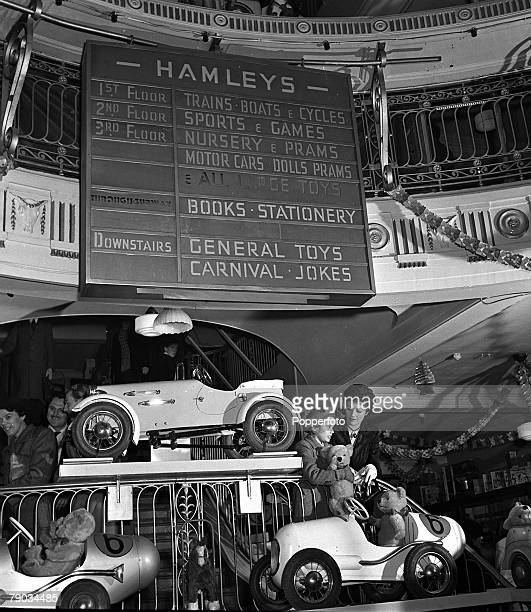 London England British film star Margaret Lockwood and her daughter Toots are pictured Christmas shopping at the Hamleys toy store