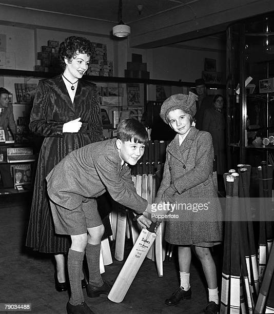 London England British film star Margaret Lockwood and her daughter Toots are pictured looking at sporting equipment as they do their Christmas...
