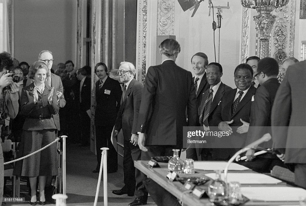 British delegation at rhodesia and zimbabwes conference pictures british prime minister margaret thatcher applauds members of the zimbabwe and rhodesian delegations as they platinumwayz