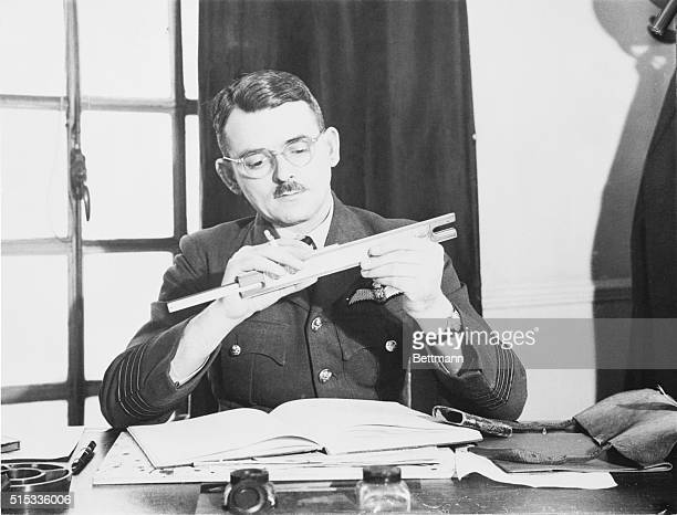 Embarrassed Rocketeer Making a calculation on a slide rule here is Group Captain Frank Whittle of the British Royal Air Force who found himself in...