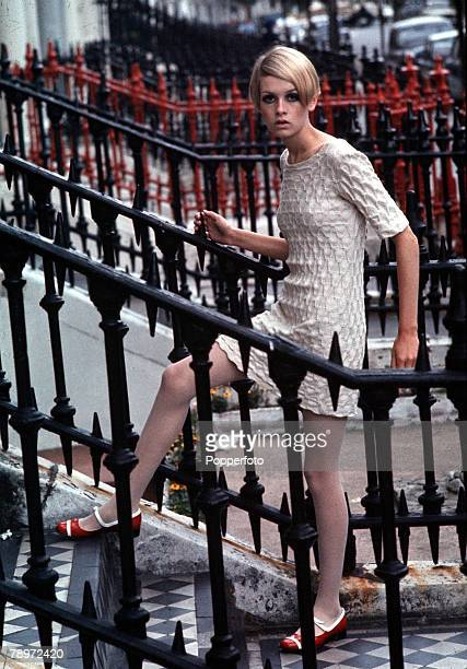 London England Famous sixties model Twiggy poses wearing a mini dress against some railings on the steps 1966