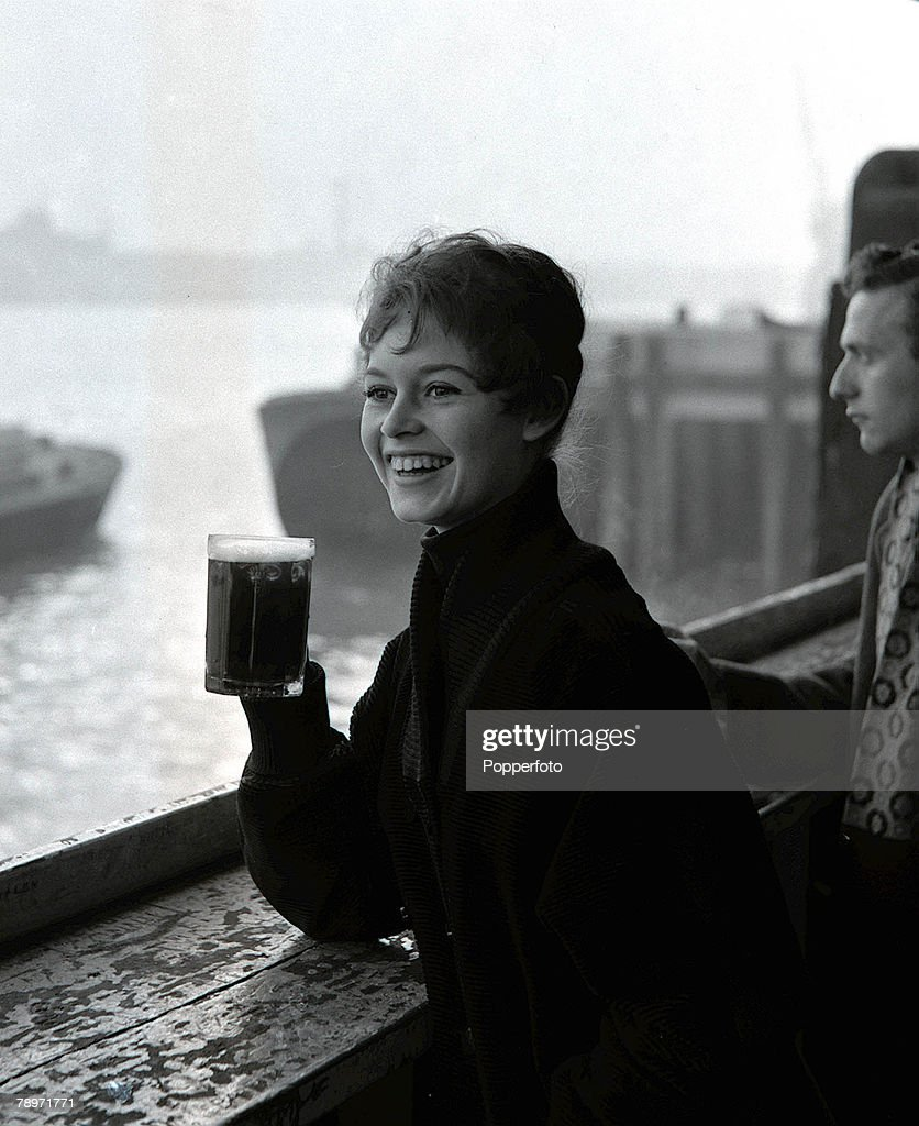 London, England, French actress Brigitte Bardot enjoying a pint of beer while on a visit to London, 1955