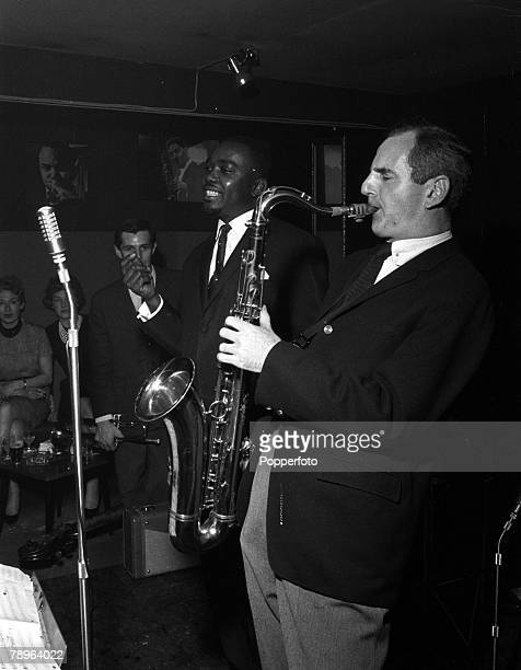 London, England Gala opening of the Ronnie Scott Club, Jazz musician Ronnie Scott is pictured playing the saxophone