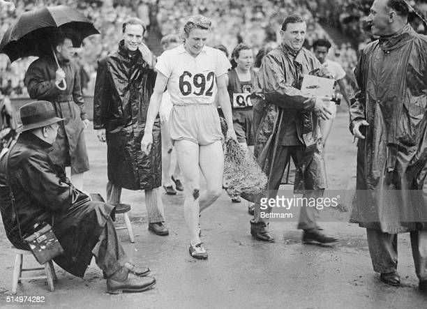 London, England: Mrs. Blankers-Koen , won her third Olympic title when she won the 200 Meters event at Wembley today. She had previously won the 100...