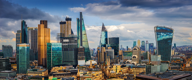 London, England - Panoramic skyline view of Bank and Canary Wharf, London's leading financial districts with famous skyscrapers 1028622820