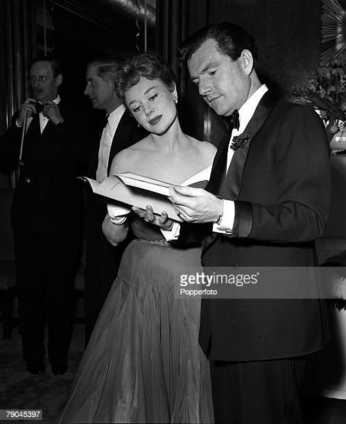 London England Pictured at the British Film Academy Awards at the Odeon Cinema Leicester Square are actress Glynis Johns and actor Kenneth More