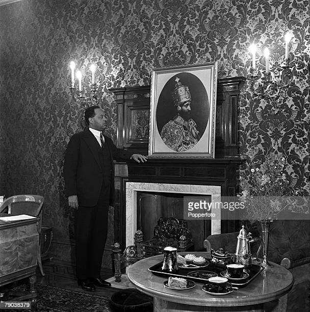 London England Professor Gabre the Abyssinian Minister to Britain looks at a portrait of the Emperor of Abyssinia in his office at Princes Gate