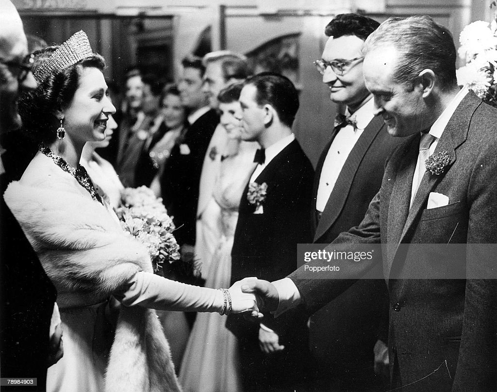 1954. London, England. Queen Elizabeth II shakes hands with US comedian Bob Hope at the Palladium, when the performers were presented to her after the Royal Variety Show. : News Photo