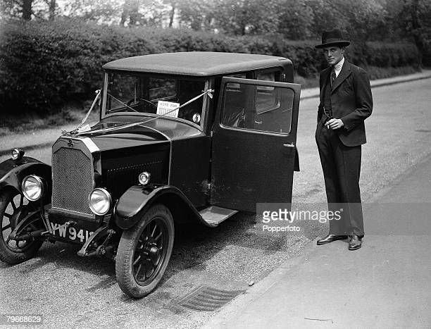London, England, Randolph Churchill, son of politician Winston Churchill, standing next to his motorcar before setting out to campaign for his father...