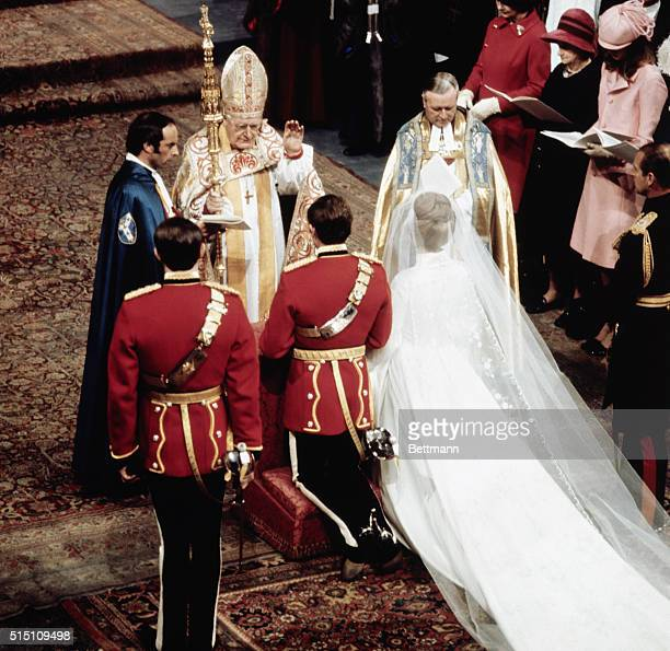 The Archbishop of Canterbury Dr Michael Ramsey blesses Prince Anne and Captain Mark Phillips during their wedding ceremony in Westminster Abbey