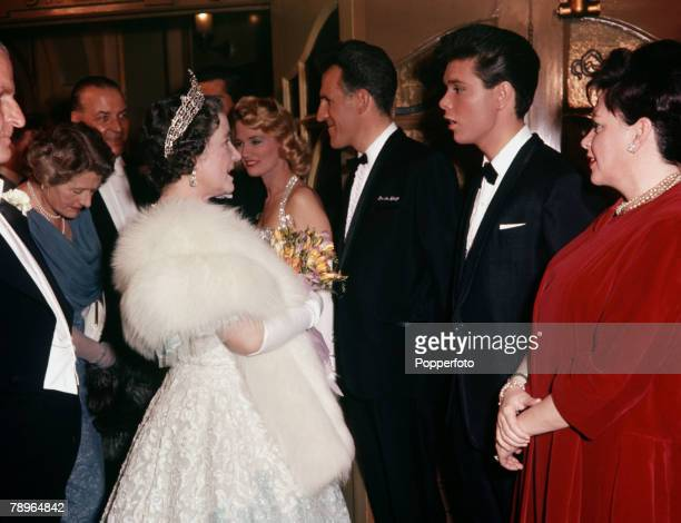 London England The Queen Mother is pictured at a performance in aid of the St John's Ambulance Brigade at the Palladium Among the entertainers she is...