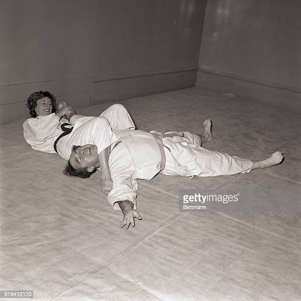 6/19/1960 London England United Press International reporter Robert Musel is the fellow having a hard time with the hands of Mrs Gret Stott women's...