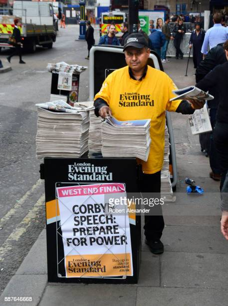 London Evening Standard newspaper distributor hands out copies of the newspaper in front of London Victoria train station in London, England. The...