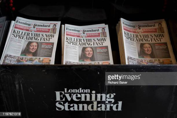 London Evening Standard newspapers with a headline about the latest on the rapid spread of the Chinese-source killer Coronavirus on their front...