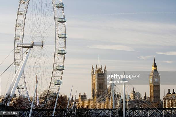 london eye and houses of parliament - london eye stock pictures, royalty-free photos & images
