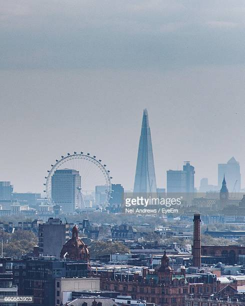 london eye and shard in city against sky - london eye stock pictures, royalty-free photos & images