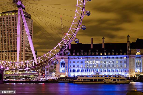 london eye with thames and aquarium  by night - london aquarium stock photos and pictures