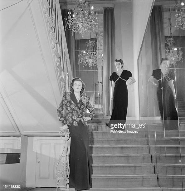 London Fashion Designers: The Work Of Members Of The Incorporated Society Of London Fashion Designers In Wartime, London, England, UK Two models pose...
