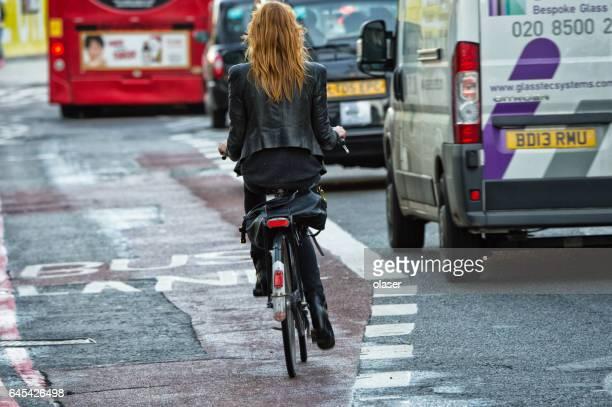 London fedmale bicyclist in traffic