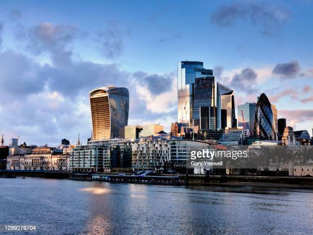 london financial district city skyline at sunset - horizon over land stock pictures, royalty-free photos & images