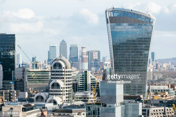 london financial district skyline with city and canary wharf skyscrapers, england, uk - canary wharf stock photos and pictures