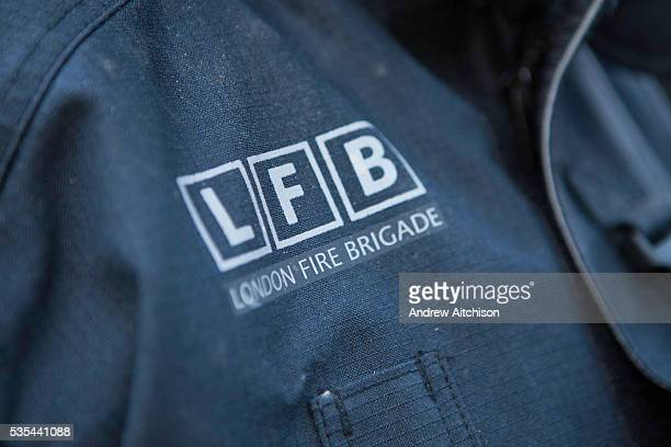 London Fire Brigade, a close up of the logo on a firemand jacket.