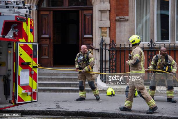 London Fire Brigade attend to a small building fire underneath a stairway below the kitchen on 3rd March 2020 in 28 Great Smith Street in London,...